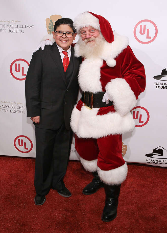 Santa with actor Rico Rodriguez at the 2012 National Christmas Tree Lighting Ceremony at President's Park in Washington, D.C.,  on Dec. 6, 2012. Photo: Paul Morigi, Getty Images / 2012 Paul Morigi