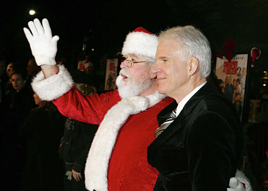 "Santa with actor Steve Martin at the premiere of ""Cheaper By The Dozen 2"" at the Mann Village Theatre in Westwood, Calif.,  on Dec. 13, 2005. Photo: Kevin Winter, Getty Images / 2005 Getty Images"