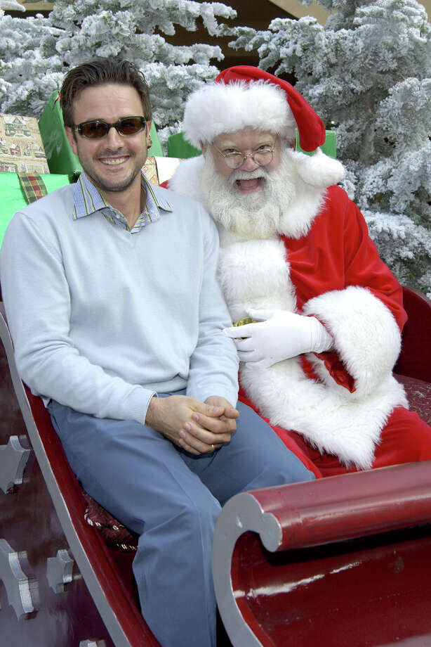 "Santa with actor David Arquette at the premiere of the IMAX animated film ""Santa Vs. The Snowman 3D"" at the IMAX theatre at The Bridge in Culver City, Calif., on Oct. 27, 2002. Photo: Vince Bucci, Getty Images / 2002 Getty Images"