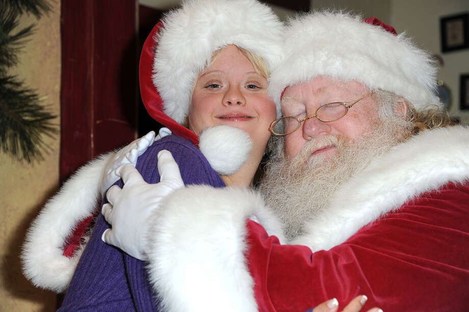 Santa with actress Lauren Potter at the Westminster Mall's Caring Santa event in Westminster, Calif., on Dec. 2, 2012. Photo: Allen Berezovsky, Getty Images / 2012 Allen Berezovsky