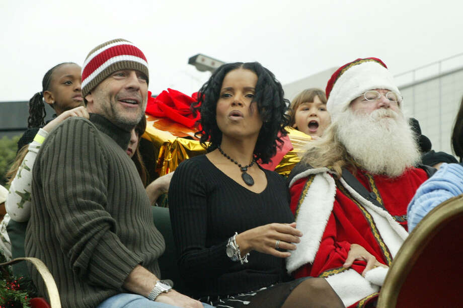 Santa with actors Bruce Willis and Victoria Rowell at the Foster Care: Learning to look at Family in a New Way event at Avalon in Hollywood, Calif.,  on Dec. 7, 2003. Photo: Frazer Harrison, Getty Images / 2003 Getty Images