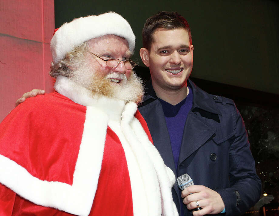 Santa with singer Michael Bublé at the launch of Brown Thomas' Christmas windows in Dublin, Ireland, on Nov. 18, 2011. Photo: Phillip Massey, Getty Images / 2011 Phillip Massey