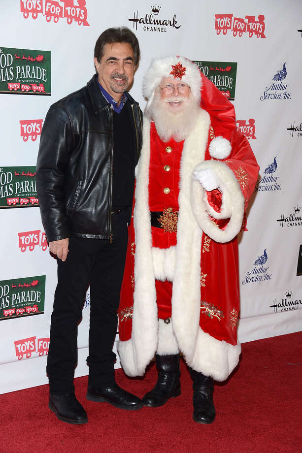 Santa with actor Joe Mantegna at the Hollywood Christmas Parade Benefiting Marine Toys For Tots in Hollywood, Calif.,  on Nov. 25, 2012. Photo: Amanda Edwards, Getty Images / 2012 Amanda Edwards