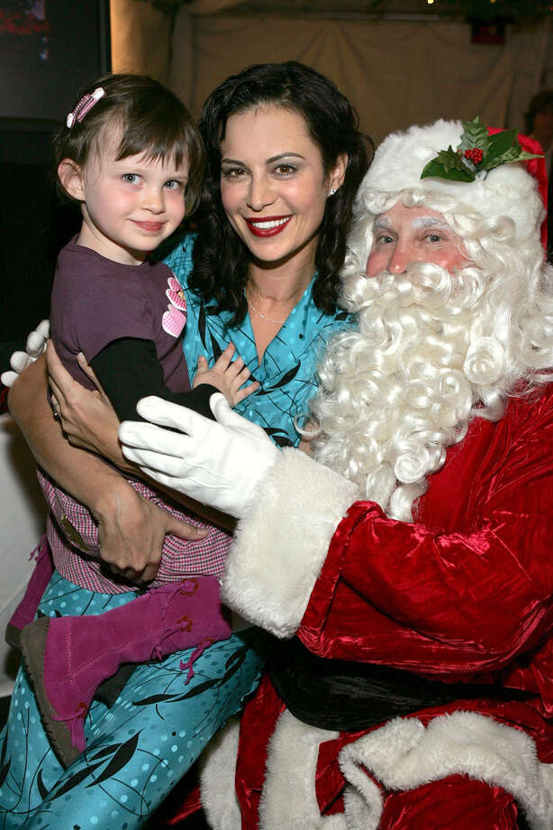 "Santa with actress Catherine Bell and her daughter Gemma at the Church of Scientology's Christmas Stories XIV ""An Evening of Holiday Joy"" at the Church of Scientology Celebrity Centre in Hollywood, Calif.,  on Dec. 2, 2006. Photo: Frazer Harrison, Getty Images / 2006 Getty Images"