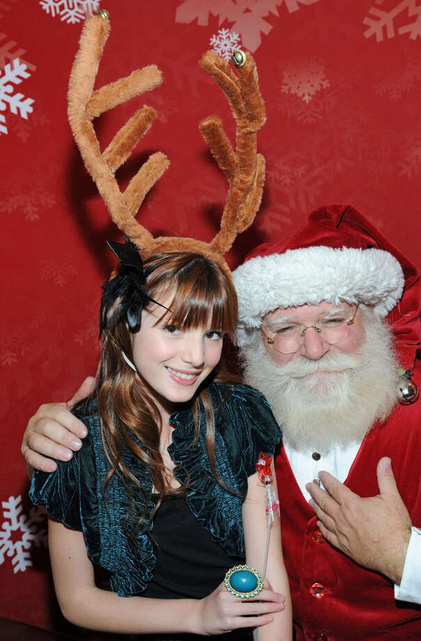 """Santa with actress Bella Thorne at the JCPenney's """"Joy of Giving"""" party held at Sunset Tower Hotel in West Hollywood, Calif., on Dec. 15, 2009. Photo: Kevin Parry, Getty Images / 2009 WireImage"""