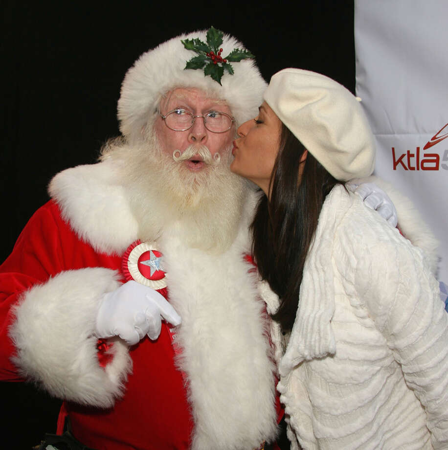 Santa with actress Constance Marie at The 75th Annual Hollywood Christmas Parade in  Hollywood, Calif., on Nov. 26, 2006. Photo: Frederick M. Brown, Getty Images / 2006 Getty Images