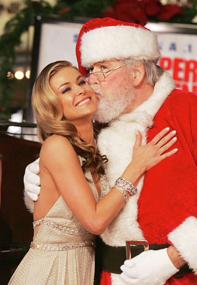 "Santa and actress Carmen Electra at the premiere of ""Cheaper By The Dozen 2"" at the Mann Village Theatre in Westwood, Calif., on Dec. 13, 2005. Photo: Kevin Winter, Getty Images / 2005 Getty Images"