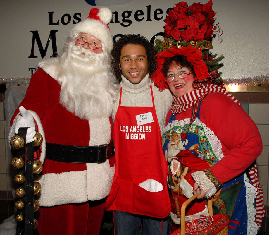 Santa with actor Corbin Bleu and Mrs. Claus at Christmas Eve at the Los Angeles Mission in Los Angeles on Dec. 24, 2008. Photo: Mark Sullivan, Getty Images / 2008 Mark Sullivan