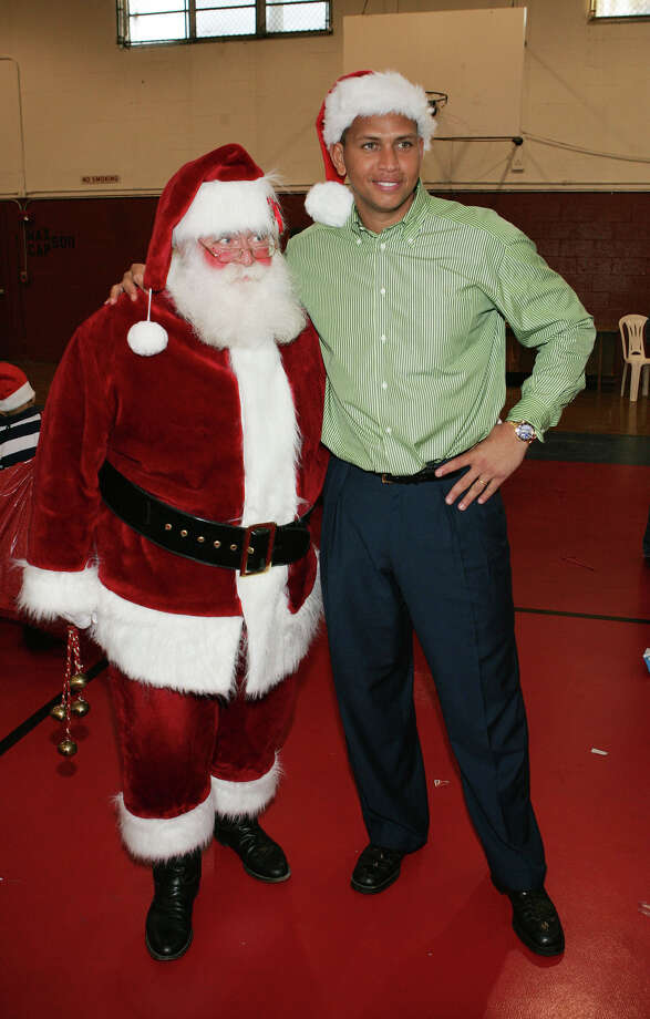 Santa with New York Yankees third baseman Alex Rodriguez at the Boys and Girls Club in Miami on Dec. 13, 2005. Photo: Alexander Tamargo, Getty Images / 2005 Alexander Tamargo