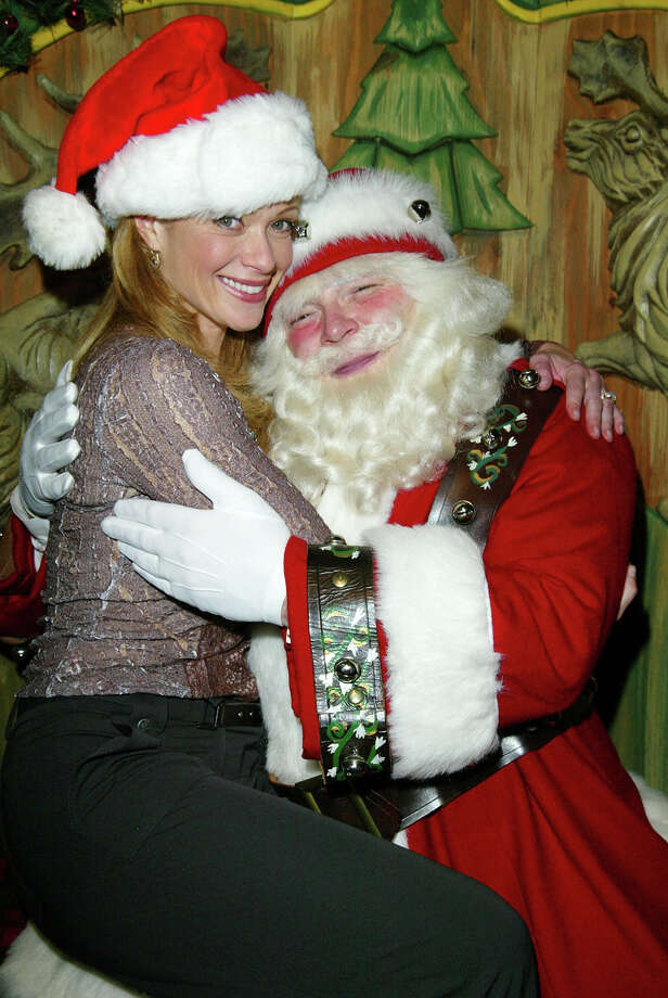 Santa with actress Lauren Holly at Santa's Workshop at Macy's Herald Square in New York City on  Nov. 25, 2002. Photo: Matthew Peyton, Getty Images / 2002 Getty Images