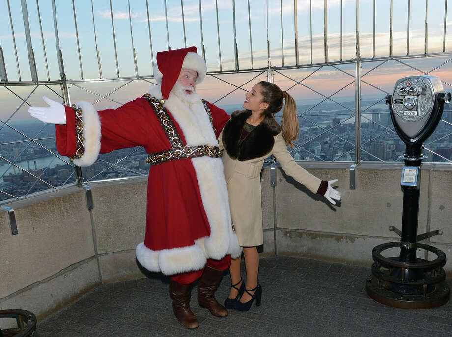 Santa with actress/singer Ariana Grande at The Empire State Building in New York City on Nov. 25, 2013. Photo: Slaven Vlasic, Getty Images / 2013 Slaven Vlasic
