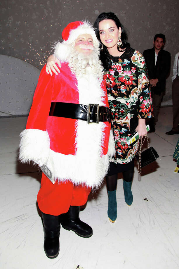Santa with singer Katy Perry at the Lunt-Fontanne Theatre in New York City on Dec. 12, 2012. Photo: Charles Eshelman, Getty Images / 2012 Charles Eshelman
