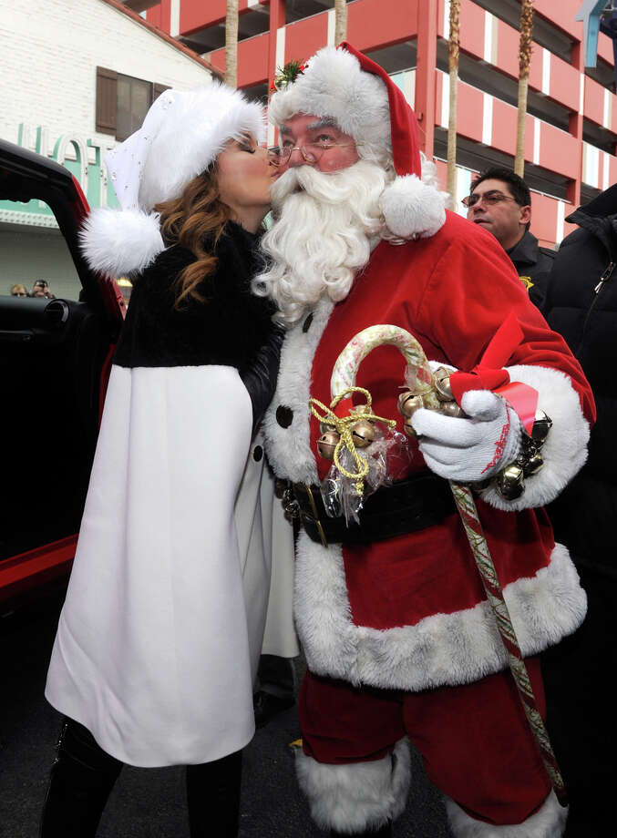 Santa with singer Shania Twain at the ninth annual Las Vegas Great Santa Run benefiting Opportunity Village in Las Vegas on Dec. 7, 2013. Photo: David Becker, Getty Images / 2013 David Becker