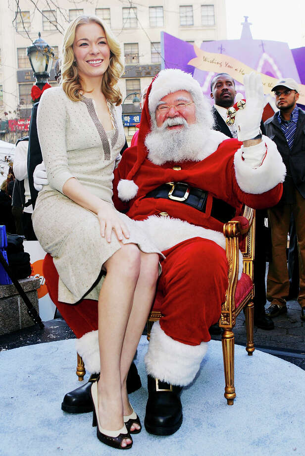 "Santa with singer LeAnn Rimes at MasterCard's ""Home For The Holidays"" national sweepstakes kick-off event at Greeley Square Park in New York City on  Nov. 30, 2005. Photo: Evan Agostini, Getty Images / 2005 Getty Images"