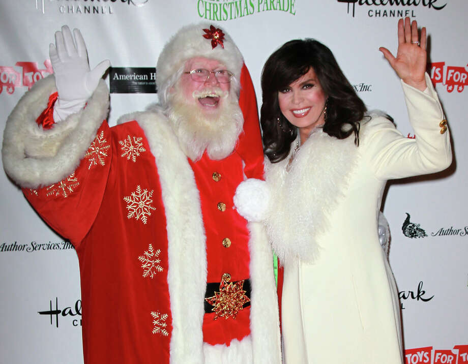 Santa and singer Marie Osmond at the 80th anniversary Hollywood Christmas Parade benefiting Marine Toys for Tots in Hollywood, Calif,. on Nov. 27, 2011. Photo: David Livingston, Getty Images / 2011 David Livingston