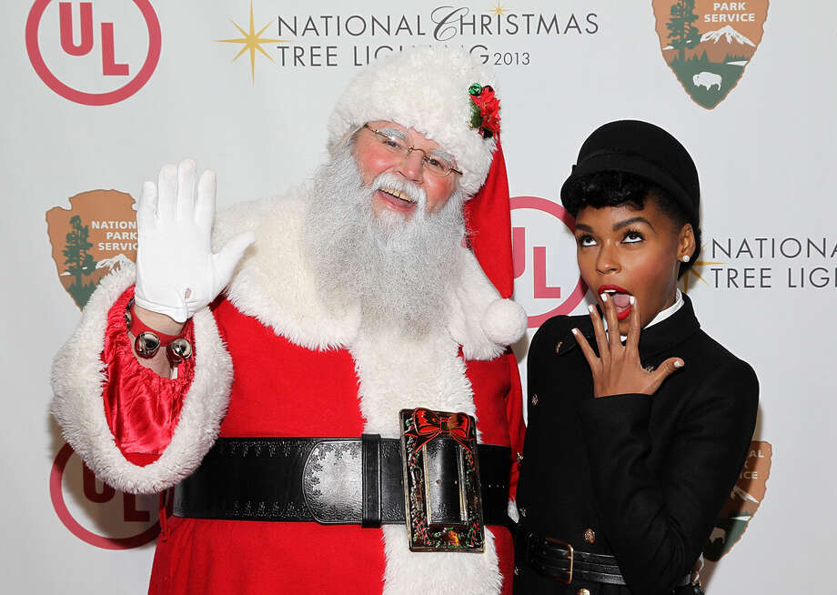 Santa and singer Janelle Monae at the National Christmas Tree Lighting Ceremony in President's Park in Washington, D.C., on Dec. 6, 2013. Photo: Paul Morigi, Getty Images / 2013 Paul Morigi