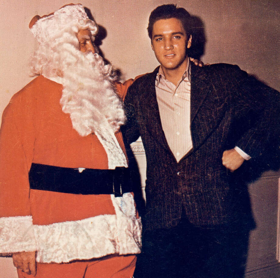 Santa with singer Elvis Presley in 1965. Photo: Michael Ochs Archives, Getty Images / Michael Ochs Archives