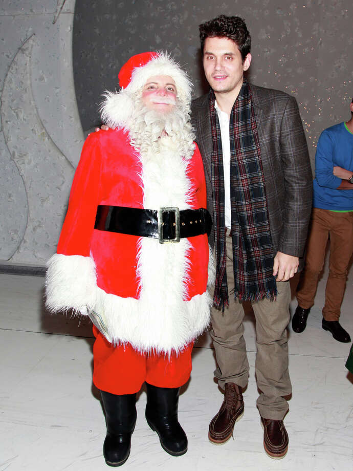 Santa with singer John Mayer at the Lunt-Fontanne Theatre in New York City on Dec. 12, 2012. Photo: Charles Eshelman, Getty Images / 2012 Charles Eshelman