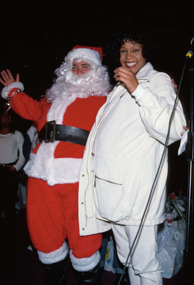 Santa with pregnant singer Whitney Houston in 1990. Photo: Time Life Pictures, Getty Images / Time Life Pictures