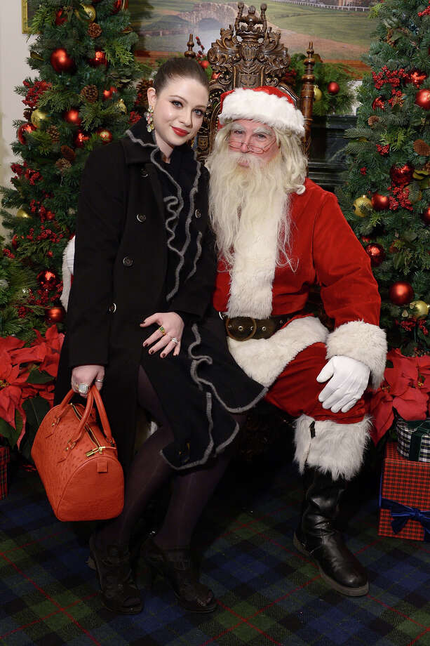 Santa with actress Michelle Trachtenberg as Brooks Brothers celebrates the holidays with St. Jude Children's Research Hospital in New York City on Dec. 12, 2013. Photo: Michael Loccisano, Getty Images / 2013 Getty Images