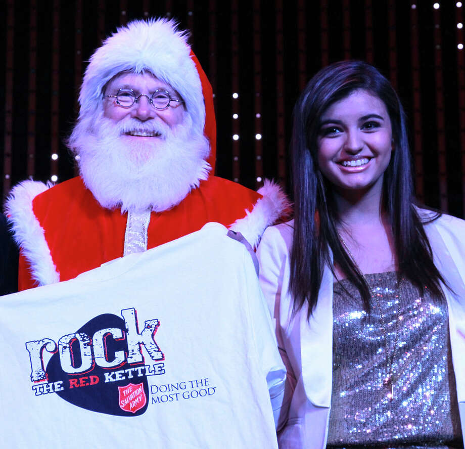 "Santa with pop singer Rebecca Black at The Salvation Army's 2nd annual ""Rock the Red Kettle"" event at Universal CityWalk in Universal City, Calif., on Dec. 17, 2011. Photo: David Livingston, Getty Images / 2011 David Livingston"