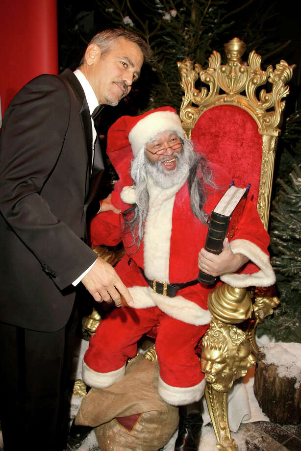 Santa with actor George Clooney at the Ein Herz fuer Kinder Gala (A Heart for Children Gala) at Ullsteinhall at Axel Springer Building in Berlin, Germany, on Dec. 6, 2008. Photo: Florian Seefried, Getty Images / 2008 Florian Seefried