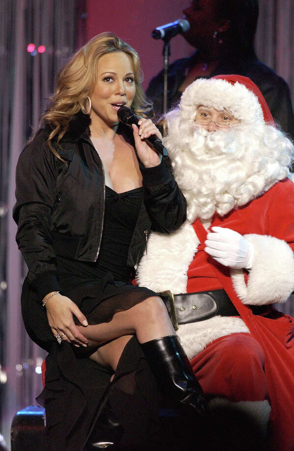 Santa with singer Mariah Carey at KIIS FM's Jingle Ball Concert at the Arrowhead Pond in Anaheim, Calif., on Dec. 19, 2002. Photo: Robert Mora, Getty Images / 2002 Getty Images