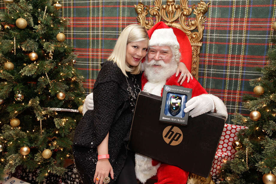 Santa with actress Tori Spelling at the 2nd Annual Santa's Secret Workshop Benefiting L.A. Family Housing at Andaz in West Hollywood, Calif., on Dec. 1, 2012. Photo: Tiffany Rose, Getty Images / 2012 Tiffany Rose