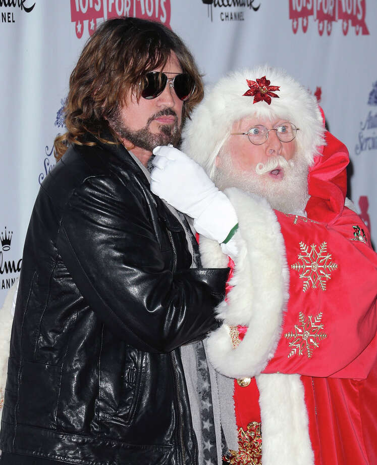 Santa with singer Billy Ray Cyrus at the Hollywood Christmas Parade benefiting the Toys for Tots Foundation in Hollywood, Calif., on Dec. 1, 2013. Photo: David Livingston, Getty Images / 2013 David Livingston