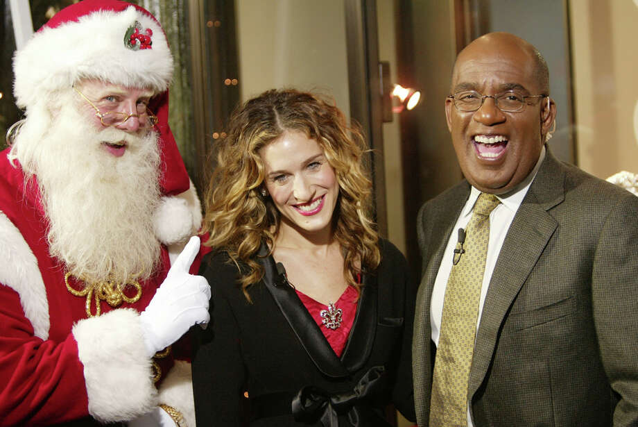 Santa with actress Sarah Jessica Parker and celebrity weatherman Al Roker at the Red Ribbon Celebration and unveiling of the Duke and Duchess of Windsor Brooch at The Cartier Mansion in New York City on Nov. 19, 2003. Photo: Evan Agostini, Getty Images / 2003 Getty Images