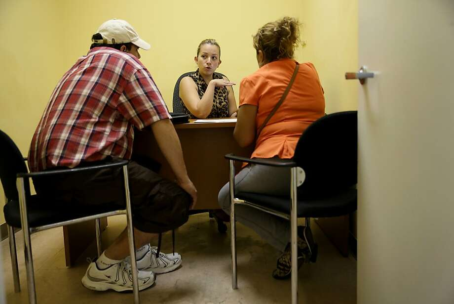 A couple listen to the options available to them under the Affordable Care Act at an assistance center in Miami. Photo: Joe Raedle, Getty Images