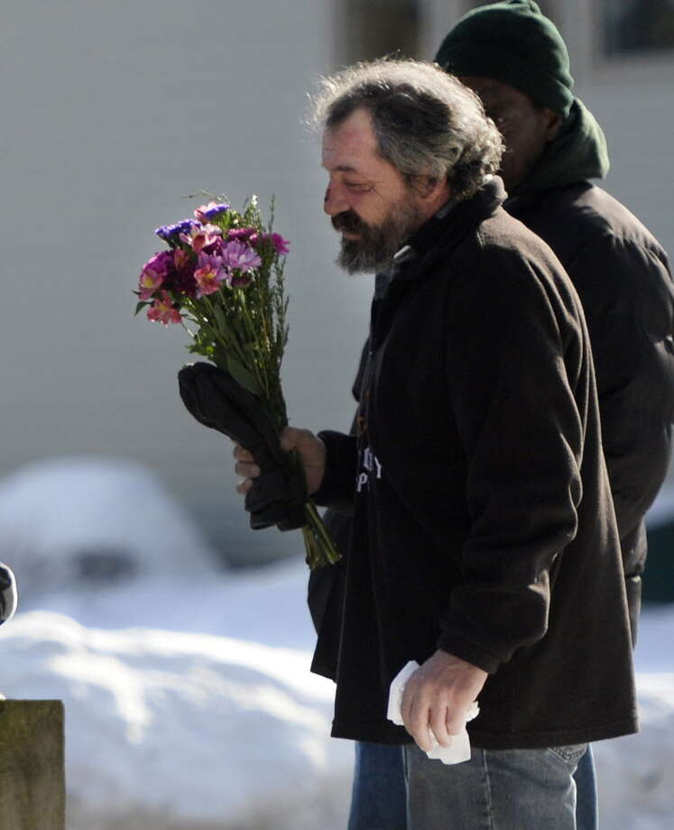 A man only identified as Jeff leaves the Presbyterian-New England Congregation Church Dec. 19, 2013, as he mourns the loss of his friend Nancy Pitts who was found frozen to death outside the Saratoga Senior Citizens building in Saratoga Springs. (Skip Dickstein / Times Union)