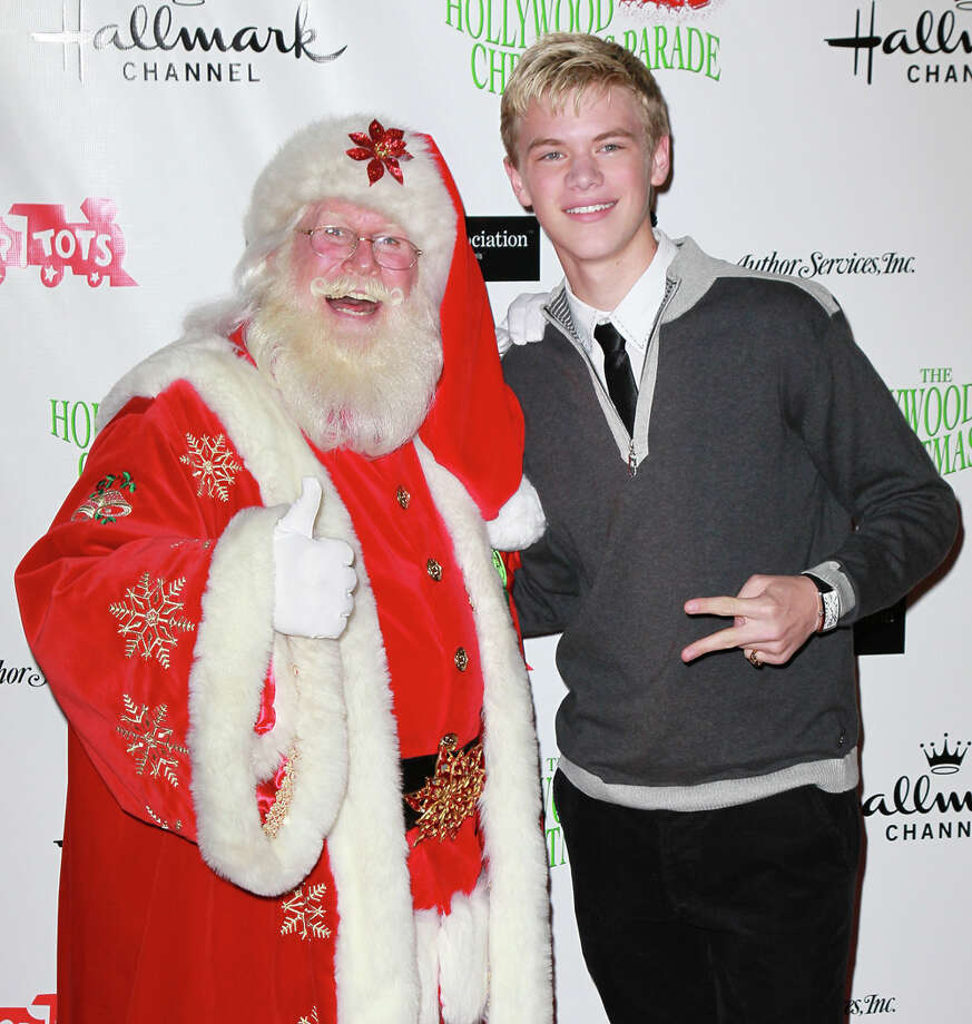Santa with actor Kenton Duty at the 80th anniversary Hollywood Christmas Parade benefiting Marine Toys for Tots in Hollywood, Calif., on Nov. 27, 2011. Photo: David Livingston, Getty Images / 2011 David Livingston