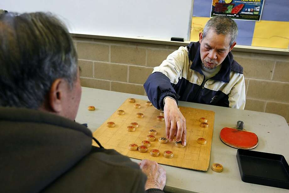 Kai Tsui (right) plays a Chinese game with Chen Gumhua at the Minnie and Lovie Ward Recreation Center in Ocean View. Photo: Michael Short, The Chronicle