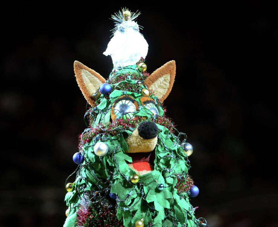The Spurs Coyote is dressed as a Christmas tree as he entertains fans during NBA action at the AT&T Center on Wednesday, Dec. 25, 2013. Photo: Billy Calzada, San Antonio Express-News / San Antonio Express-News