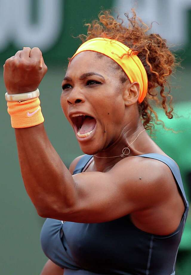 FILE - In this June 8, 2013 file photo, Serena Williams, of the U.S, celebrates a winning point as she plays Russia's Maria Sharapova during the Women's final match of the French Open tennis tournament at the Roland Garros stadium in Paris. Williams is The Associated Press' 2013 Female Athlete of the Year, easily winning a vote by news organizations. (AP Photo/Michel Euler, File) ORG XMIT: NY113 Photo: Michel Euler / AP