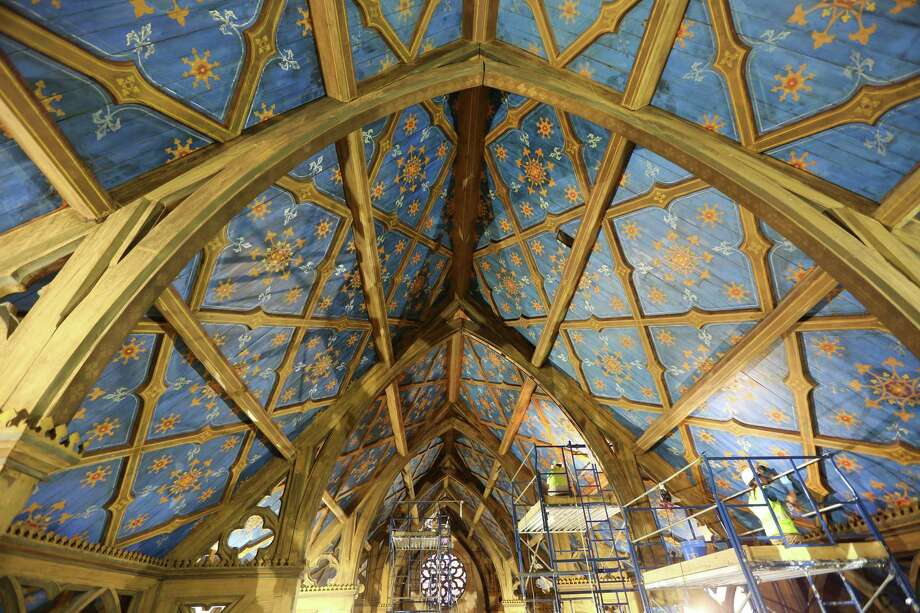 Conservators work on the ceiling of Grace Church in New York, Dec. 10, 2013. Thousands of eight-pointed stars in gold, yellow and red painted on a blue background were discovered on the ceiling during renovations under a layer of paint made to look like wood. Photo: CHESTER HIGGINS JR, New York Times / NYTNS