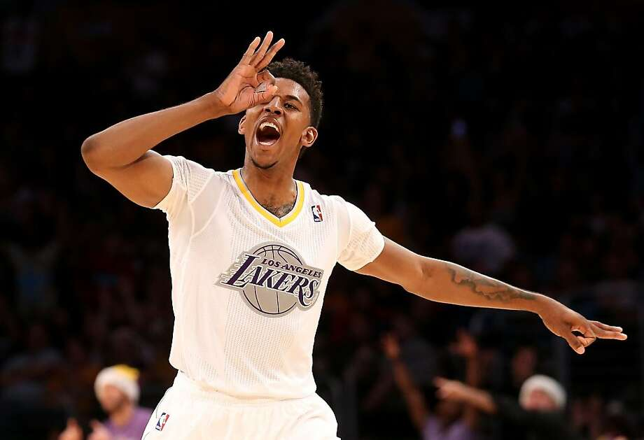 LOS ANGELES, CA - DECEMBER 25:  Nick Young #0 of the Los Angeles Lakers celebrates after making a three point basket against the Miami Heat at Staples Center on December 25, 2013 in Los Angeles, California. The Heat won 101-95.  NOTE TO USER: User expressly acknowledges and agrees that, by downloading and or using this photograph, User is consenting to the terms and conditions of the Getty Images License Agreement.  (Photo by Stephen Dunn/Getty Images) Photo: Stephen Dunn, Getty Images
