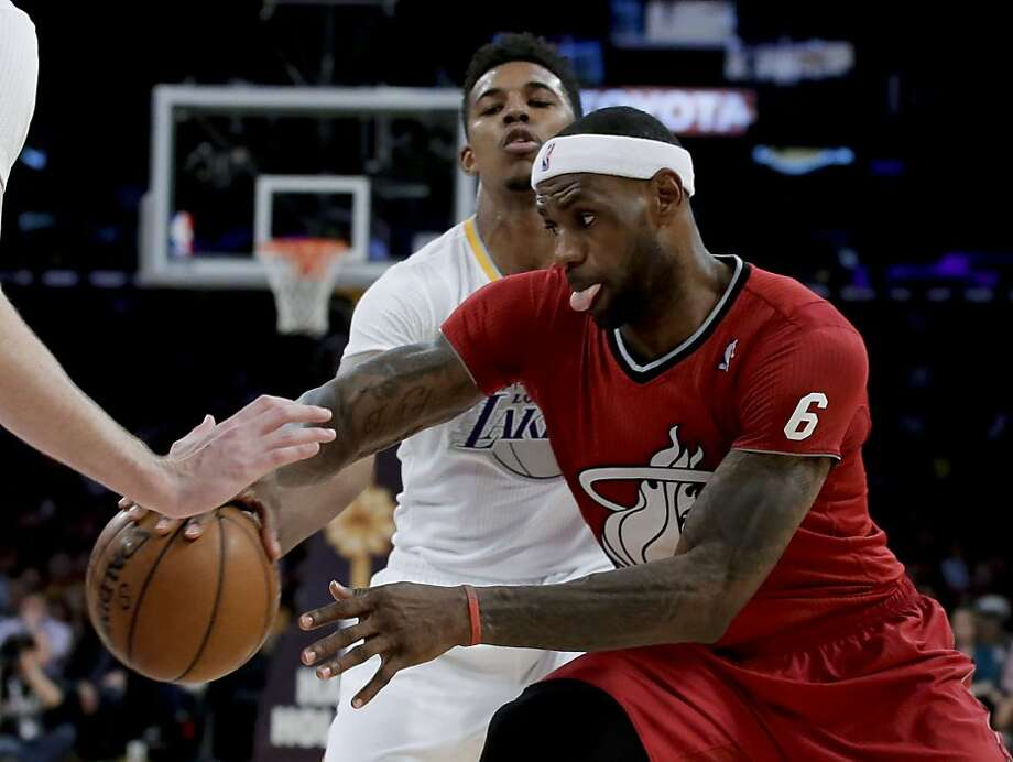 Miami Heat forward LeBron James, right, drives past Los Angeles Lakers forward Nick Young during the second half of an NBA basketball game in Los Angeles, Wednesday, Dec. 25, 2013. The Heat won 101-95. (AP Photo/Chris Carlson) Photo: Chris Carlson, Associated Press