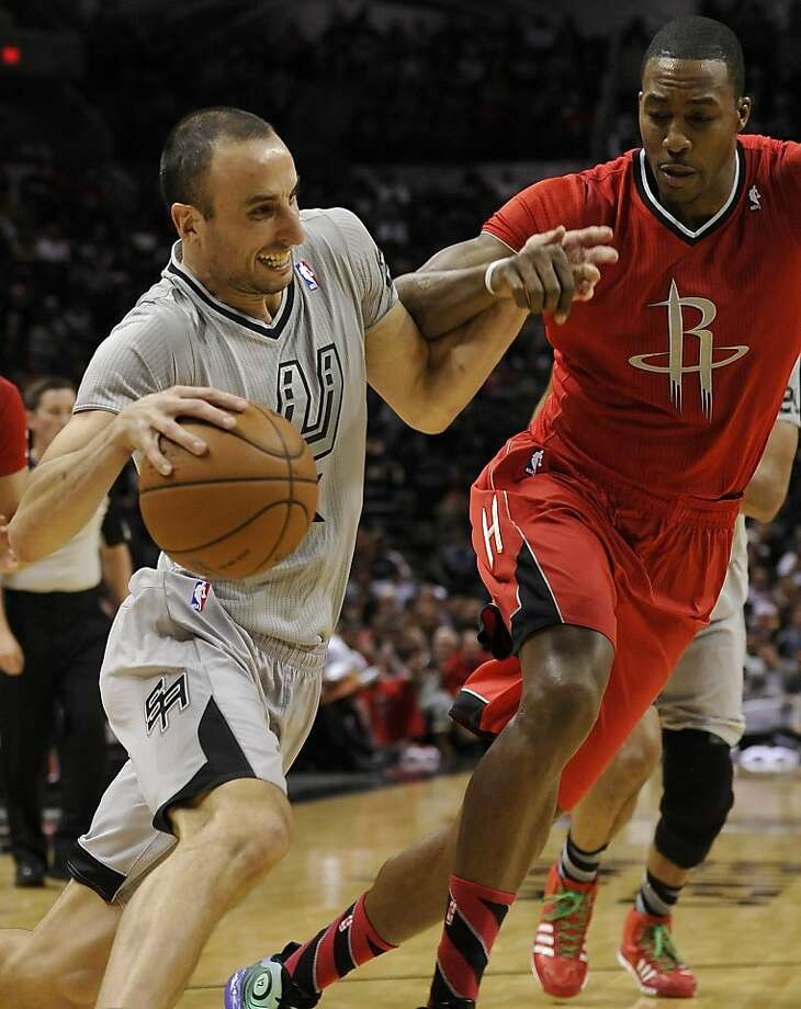 San Antonio Spurs guard Manu Ginobili, left, of Argentina, drives around Houston Rockets forward Dwight Howard during the first half of an NBA basketball game Wednesday, Dec. 25, 2013, in San Antonio. (AP Photo/Darren Abate) Photo: Darren Abate, Associated Press