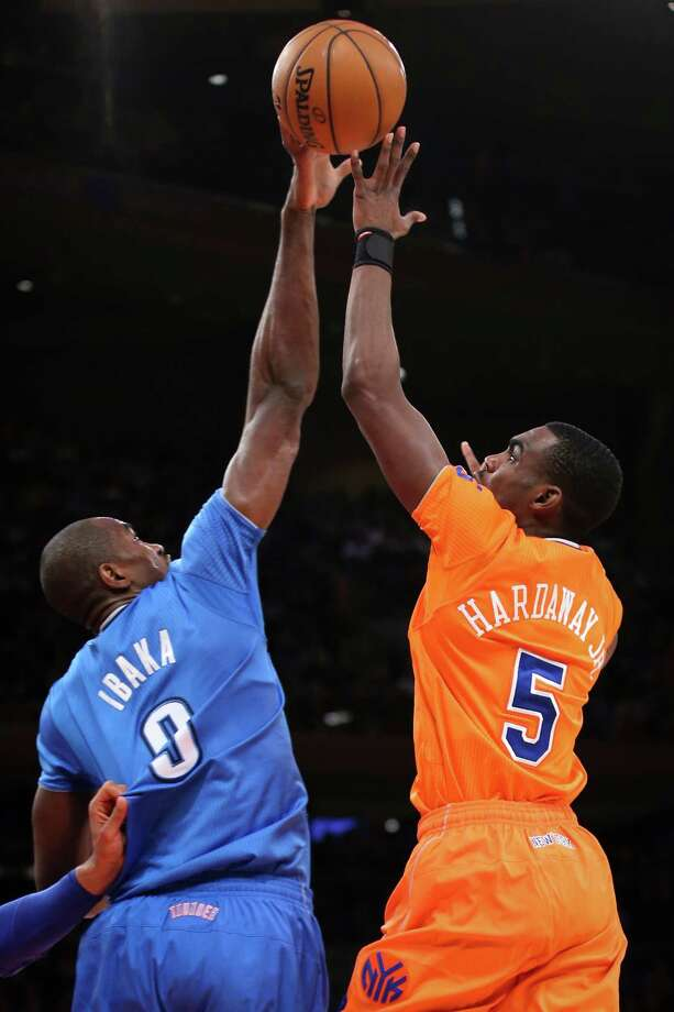 Oklahoma City Thunder power forward Serge Ibaka (9) blocks a shot from New York Knicks shooting guard Tim Hardaway Jr. (5) during the first half of their NBA basketball game at Madison Square Garden, Wednesday, Dec. 25, 2013, in New York. (AP Photo/John Minchillo) ORG XMIT: NYJM108 Photo: John Minchillo / FR170537 AP
