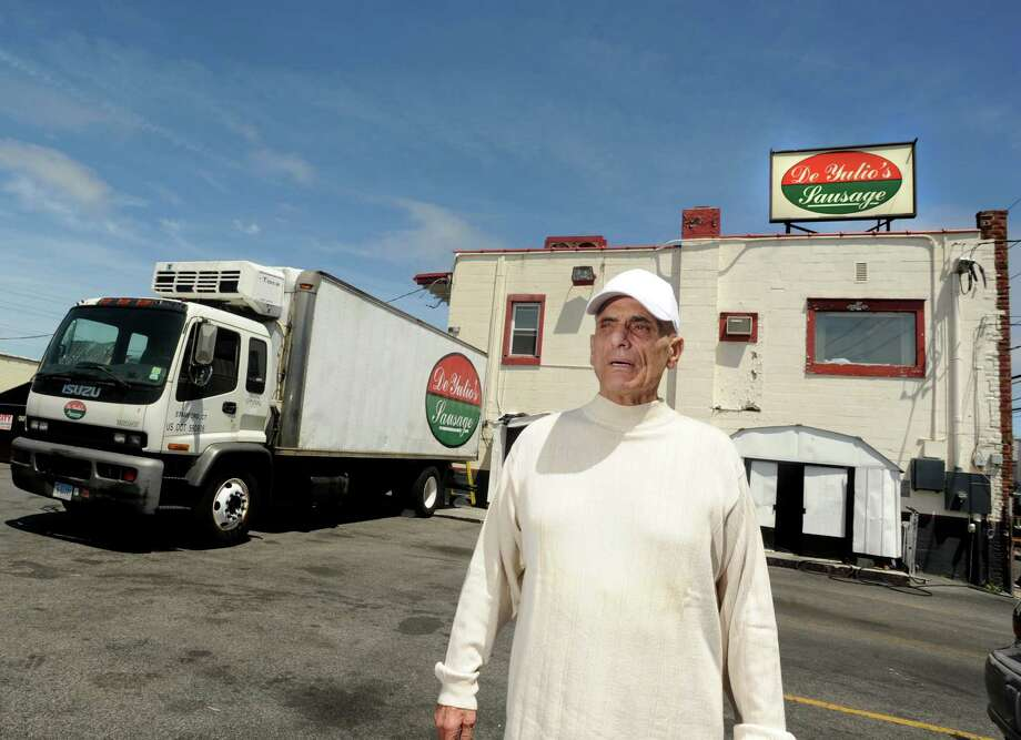 Nick De Yulio, owner of De Yulio's Sausage Company, stands outside his business on Myrtle Ave. in Stamford on May 7. De Yulio has an agreement with a Bronx, N.Y., company to produce his sausage while he moves his business to a new location. Photo: Cathy Zuraw / Connecticut Post