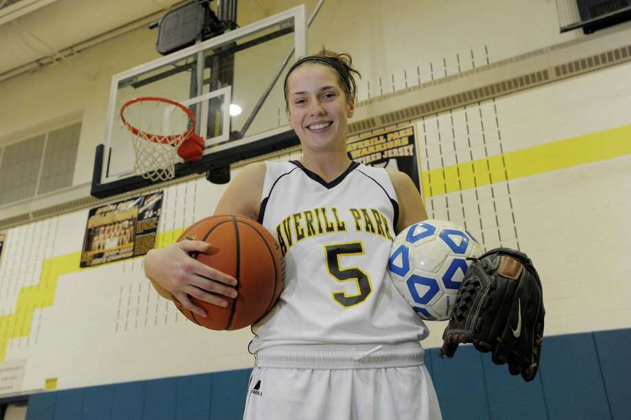 Averill Park High School senior, Kelly Donnelly, poses in her basketball uniform with a basketball, a soccer ball and her softball glove inside the gym at the school on Thursday, Dec. 19, 2013 in Averill Park, NY.   (Paul Buckowski / Times Union) Photo: PAUL BUCKOWSKI / 10025107A