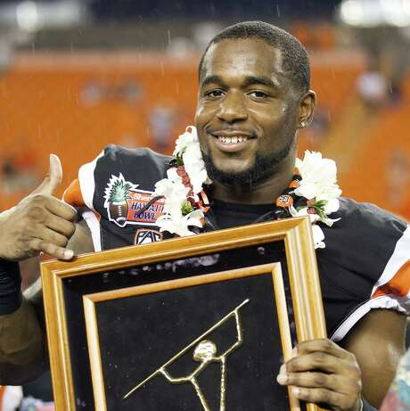 Oregon State's Rashaad Reynolds was named MVP of the Hawaii Bowl after returning two fumbles for TDs vs. Boise State. Photo: Eugene Tanner / Associated Press / FR168001 AP