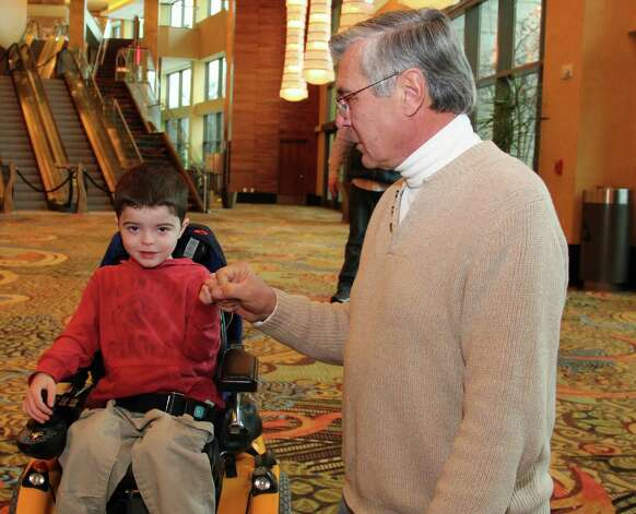 """Stephen Penthlen of Latham was one of 11 recipients of the """"Foxwoods Holiday Wishes"""" program. Penthlen used his savings to build a handicapped accessible home next door to his own for his family when his grandson Charlie was diagnosed with muscular dystrophy and he was honored with a weekend getaway to Foxwoods at the request of his family. (Courtesy Foxwoods Resort)"""