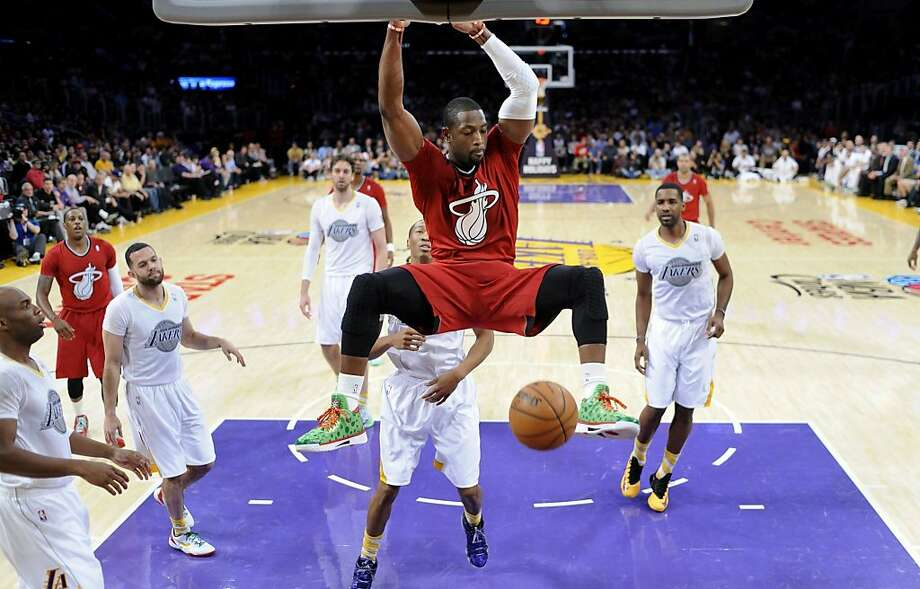 Miami's Dwyane Wade just seems above it all as he dunks for two of his 23 points in Los Angeles on Wednesday. Photo: Wally Skalij, McClatchy-Tribune News Service