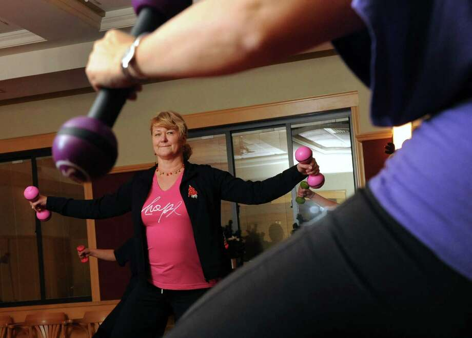 Barbara-Jean Heinbach participates in a Zumba class at the Shaker Road Loudonville Fire Department on Wednesday, Dec. 18, 2013 in Loudonville, N.Y. Heinbach,  a life-member of the department and its health, wellness and exercise administrator, started the program five years ago for both department members and the community in hopes of raising awareness about the importance of proper exercise and diet. (Lori Van Buren / Times Union) Photo: Lori Van Buren / 00025058A