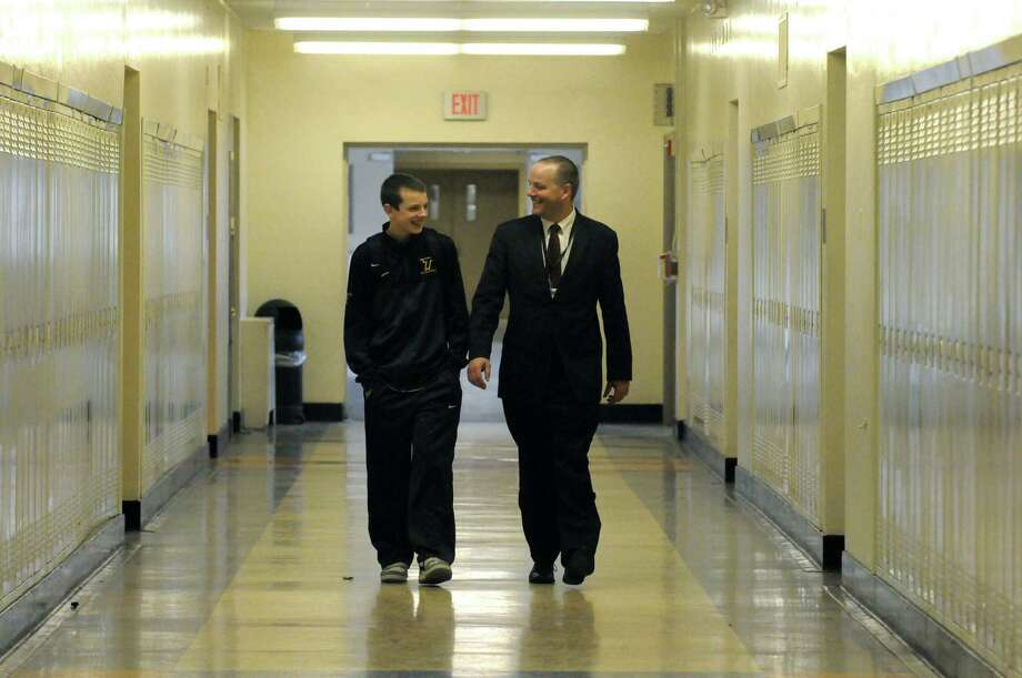 Troy City School District Superintendent John Carmello with his son Ryan Carmello who is a freshman at Troy High School on Friday Dec. 13, 2013 in Troy, N.Y. (Michael P. Farrell/Times Union) Photo: Michael P. Farrell / 00024973A