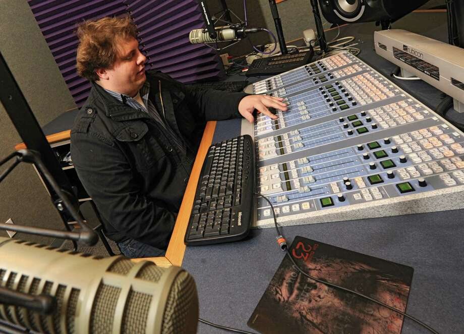 """Jamie """"Tanch"""" Tanchyk, program director and on air personality for 104.9 sits in his studio in the Albany Broadcasting studio on Tuesday, Dec. 17, 2013 in Latham, N.Y.  Tanch will be launching a classic rock station on the radio which he says will be unique. (Lori Van Buren / Times Union) Photo: Lori Van Buren / 00025064A"""