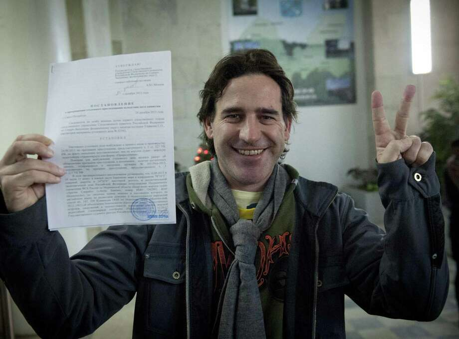 Greenpeace activist Miguel Hernan Perez Orsi from Argentina holds his amnesty document in St. Petersburg, Russia. Photo: Dmitri Sharomov / Getty Images / AFP